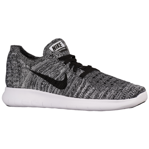 gray and black nike running shoes