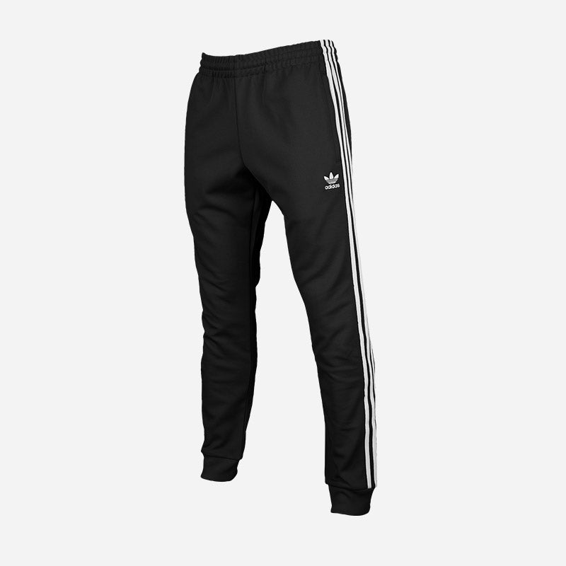 Shop the Men's adidas Originals Superstar Track Pants in black.