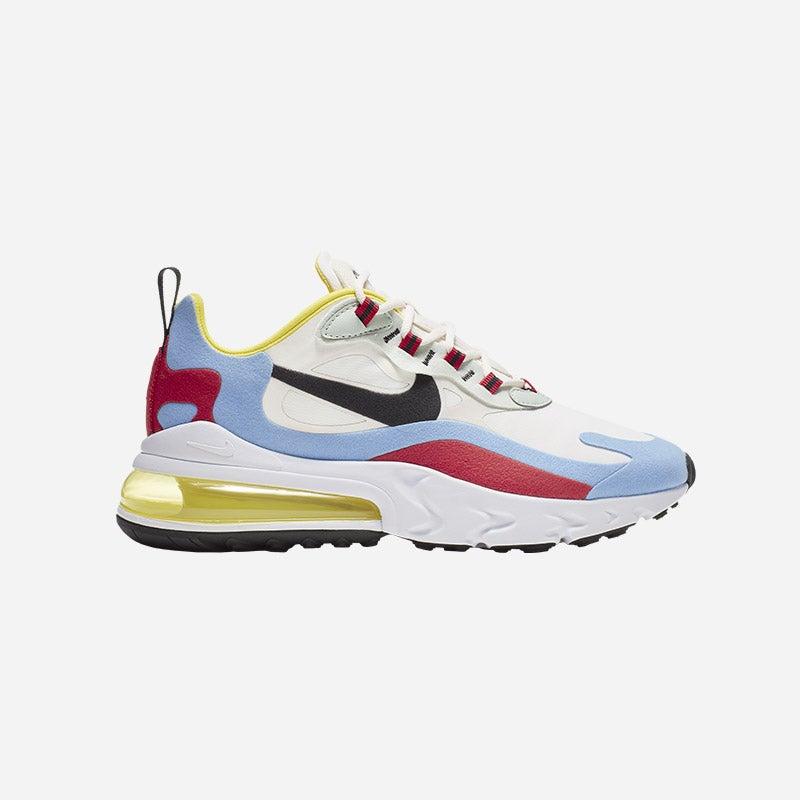 Shop the Women's Nike Air Max 270 React in Phantom/Black/Light Blue/Red/Yellow.