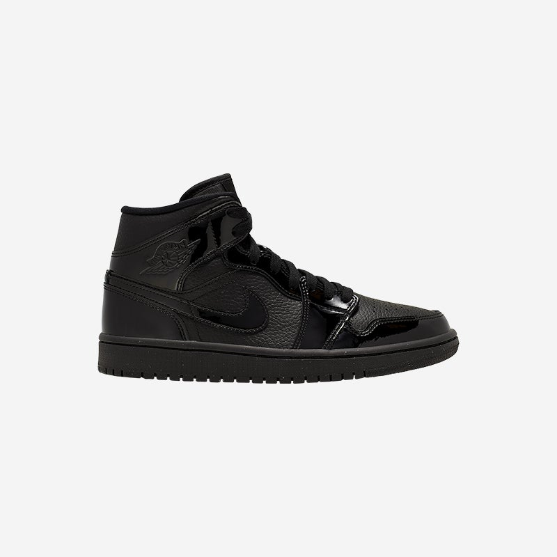Shop the Women's Jordan AJ 1 Mid in Black/Black.