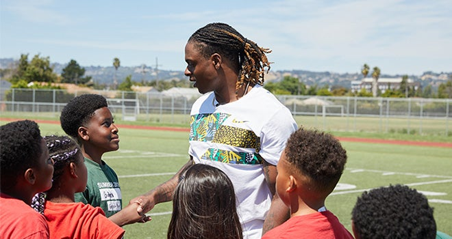 Davante Adams shaking hand of young kid from Boys and Girls Club.