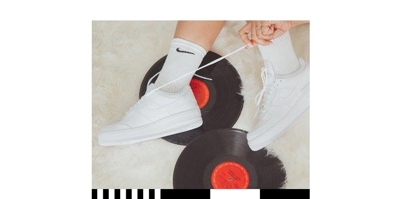 Shop Triple White Sneakers