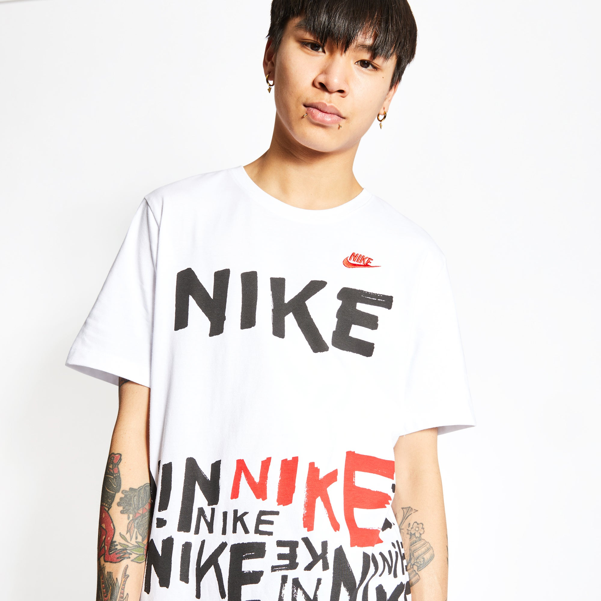 Shop Nike Essential Printed All Over Print T-shirt
