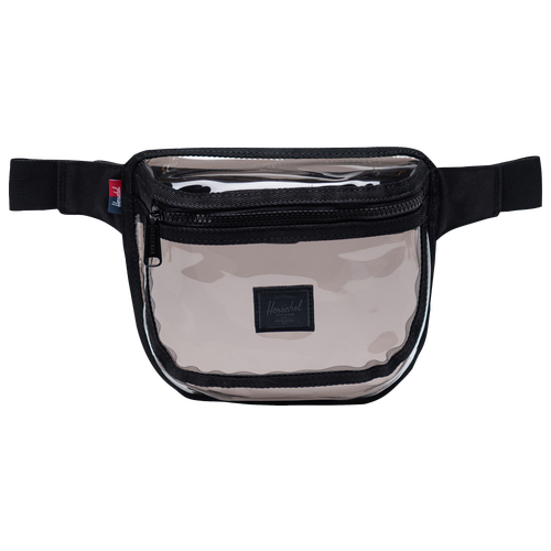 The Herschel Tinted Fifteen Waist Pack is perfect for concerts, festivals, and stadiums. Clear plastic material. Exposed trim for a pop of color. Exposed zipper. Clip-fastened adjustable webbing strap. Dimensions: 6.5\\\