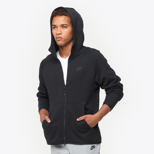 Classic comfort with a modern design — Nike\\\'s Tech Fleece Full-Zip Hoodie. The full-length, two-way zipper lets you adjust for warmth and coverage, while binding along the cuffs and hem creates a clean look. The split kangaroo pocket provides convenient storage, and you\\\'re sure to enjoy the warm and cozy three-panel hood. Take your comfort game to the next level. Elongated back hem creates a modern look and additional coverage. Features a two-way, full-length zipper. Includes a split kangaroo pocket for easy storage. 66% cotton/34% polyester. Imported.