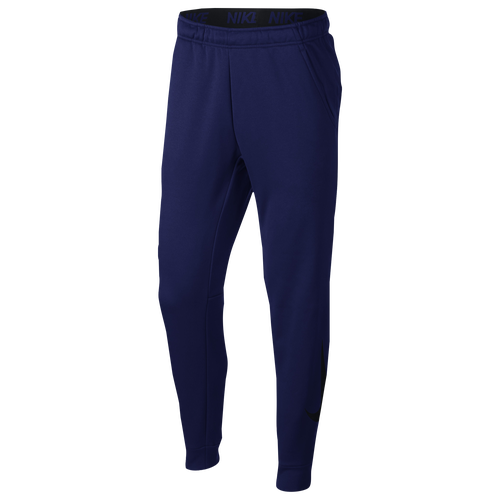 Nike Therma Men\\\'s Tapered Training Pants are made with heat-managing fabric so you can stay warm when the temperature drops. Its tapered design provides a slim fit, while side pockets offer easy-access storage for your essentials. Nike Therma fabric helps keep you warm. Tapered through the ankle for a slim fit. Side pockets provide small-item storage. Media pocket offers space for your electronic device. 100% polyester. Imported.