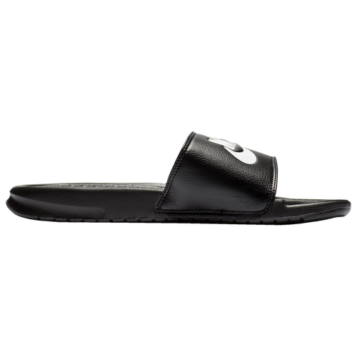 Slide Into Comfort You\\\'ll be sliding into comfort and style with the Men\\\'s Nike Benassi JDI Slide, a no-nonsense sandal design from the Swoosh. This basic, wear-with-anything slide features a clean look and maximum comfort thanks to the soft foam sole with a textured footbed for traction and a massaging feel. The perfect footwear to slide into before or after an intense workout session or game, the Benassi JDI Slide is there when you need it for low-key casual wear. Whether it\\\'s the bus ride to your next game, or a trip to the beach for some serious relaxation, the JDI Slide has you covered. This sandal is available in a number of stylish looks, from solid black treatments to eye-catching graphics covering the strap, but all feature a large Nike logo across the top for that classic sportswear look. Slip into your own pair today, available at Foot Locker in a wide variety of men\\\'s sizing and styles. Just Do It! Nike Benassi JDI Slide features: Simple two-piece design with synthetic leather strap and lightweight foam sole. Large Nike logos across the strap. Select styles also feature graphic prints. Footbed features a textured design that massages your feet with every step. Jersey lining on strap for comfort and breathability.
