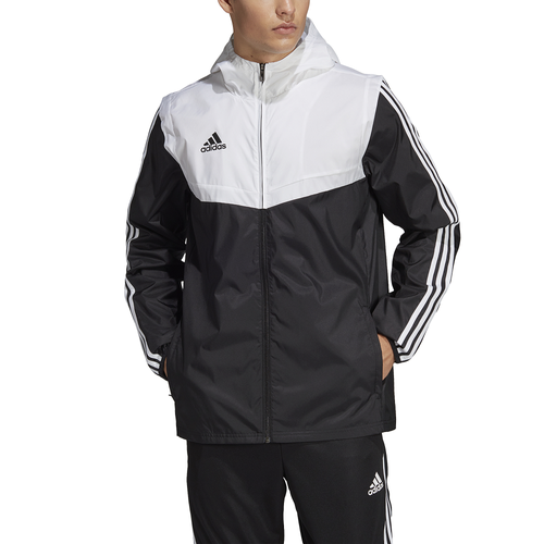 Prepare for whatever your day throws at you with the adidas Tiro Windbreaker. A breathable mesh lining, comfortable hood, and zip pockets make this football jacket a must-have. Durable, lightweight fabric forms an easy outer layer. Zip pockets let you store your essentials with ease. 100% polyester. Imported.