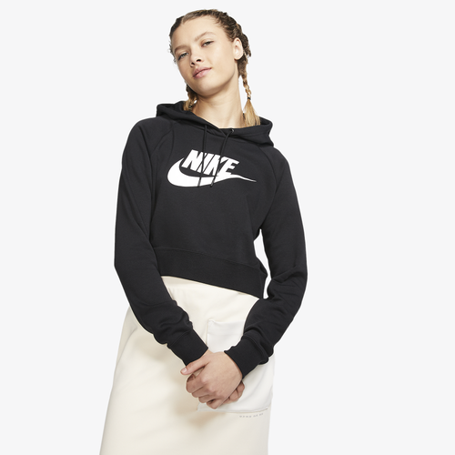 Brushed Fleece, All Day Feels The Nike Sportswear Essential Hoodie Crop keeps you stylish and sporty whether you\\\'re relaxing on the weekend or leaving a training session. A slightly cropped length hits the hip and is flattering to the feminine shape, while the hoodie style means you\\\'ll stay warm against the elements. The kangaroo pocket keeps your hands warm and provides easy storage for all your needs. Ribbed waistband and cuffs keep the hoodie out of your way as you get things done, and the raglan-style design means you can move freely. A front-and-center Futura Nike logo ties this look into the global sportswear brand that keeps you fresh day after day. Nike Sportswear Essential Hoodie Crop Features: Long-sleeved, soft and lightweight women\\\'s pullover. Slightly cropped length fits at the hips for a feminine feel. Ribbed waistband and cuffs add durability and shape retention.Hood creates a warm, relaxed feel and includes drawstring to keep the wind out.Soft, semi-brushed fleece feels soft and plush, while remaining light weight.Raglan sleeves allow you to move freely and bring a fresh design element.Kangaroo pocket keeps your hands warm. Front-and-center Futura Nike logo.80% cotton/20% polyester. Imported.