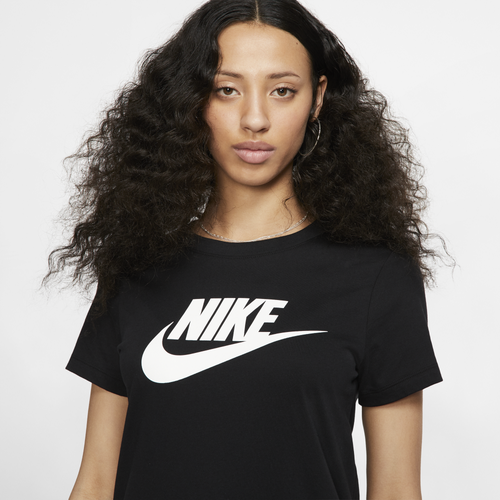 Don\\\'t miss out on iconic sporty style with a graphic tee from Nike. Features the corporate logo screen printed on the chest. 100% cotton. Imported.